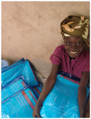 Girl in Mali holding a bednet